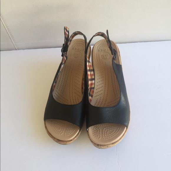 88b9b51bb38b61 CROCS Women black leather wedge sandal. Size 9